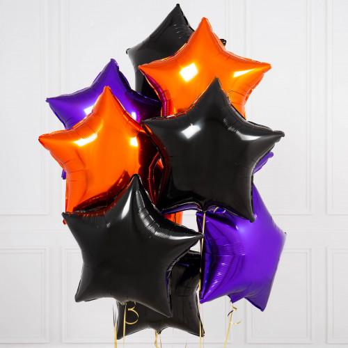 Композиция из фольгированных звезд на Хэллоуин